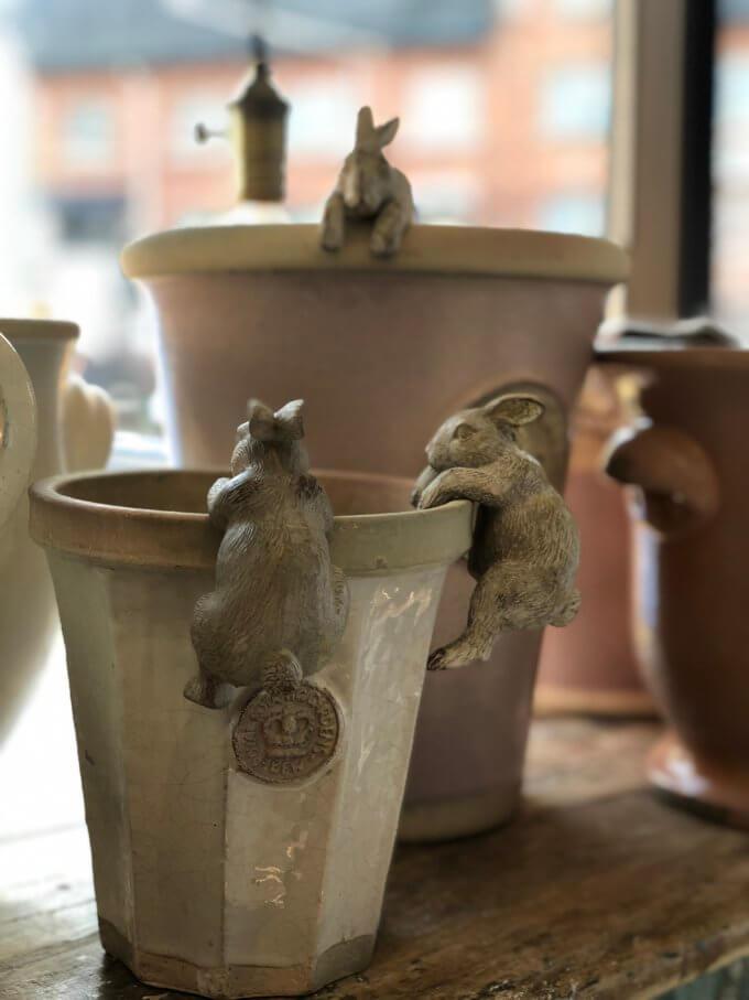bunny rabbit hanging from garden pot